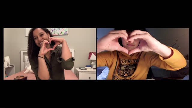 loving brother and sister form a heart shape with their hands over a video call - love emotion stock videos & royalty-free footage