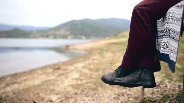 loving couple at jetty looking at beautiful lake - human limb stock videos & royalty-free footage