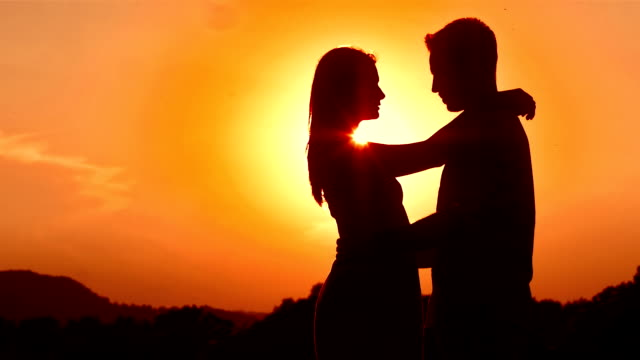hd: loving couple at sunset - affectionate stock videos & royalty-free footage