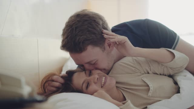 loving couple awaking - flirting stock videos & royalty-free footage