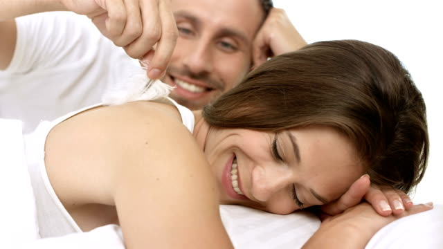 hd: loving couple cuddling in bed - tickling stock videos & royalty-free footage