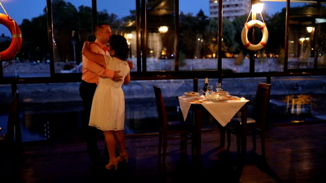 Loving couple dancing in restaurant