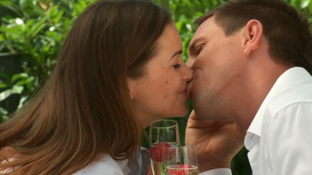 hd dolly: loving couple enjoying strawberries - desire stock videos & royalty-free footage