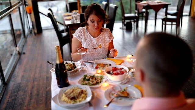 Loving couple having dinner in restaurant