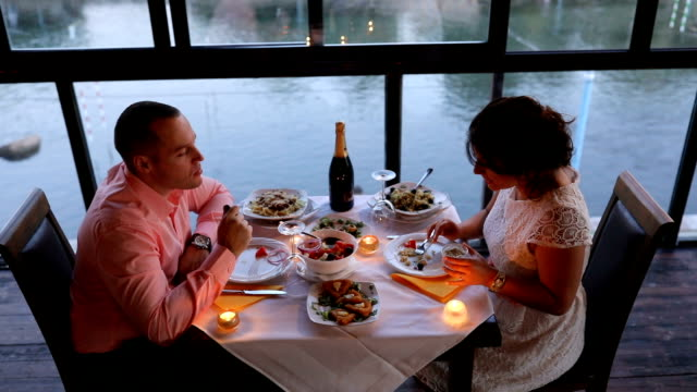 loving couple having dinner in restaurant - date night romance stock videos and b-roll footage