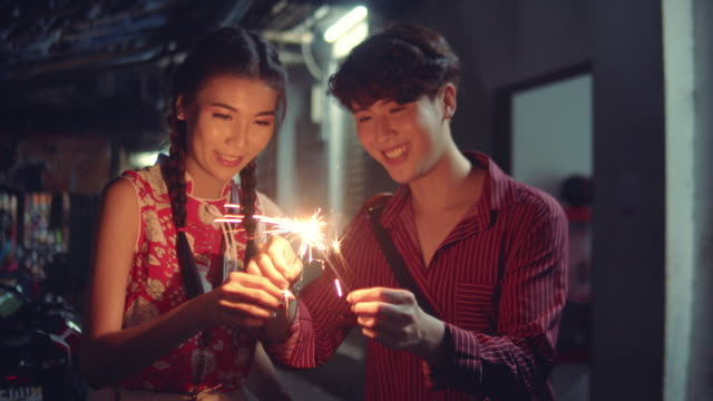 loving couple holding sparklers - chinese new year stock videos & royalty-free footage