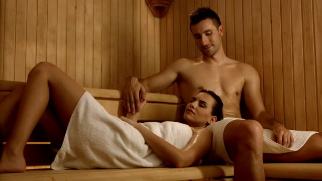 hd dolly: loving couple in the sauna - sauna stock videos and b-roll footage