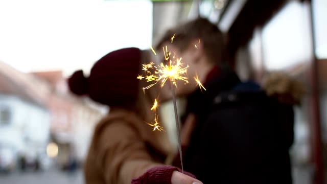 SLO MO Loving couple kissing with the sparkler