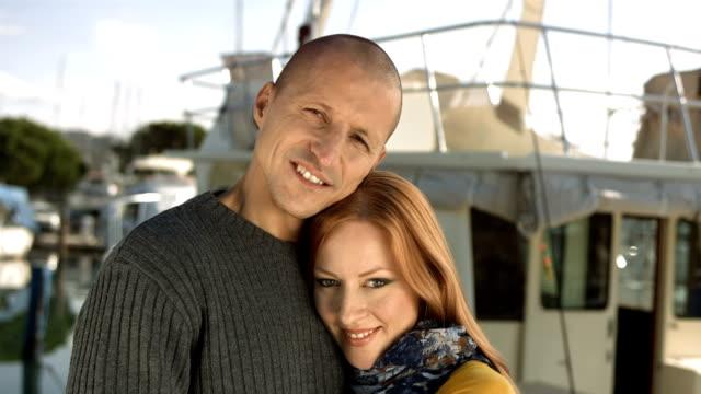 hd: loving couple posing on a dock - förtöjd bildbanksvideor och videomaterial från bakom kulisserna