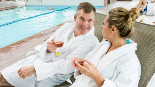 loving couple relaxing at the spa - loving cup stock videos & royalty-free footage