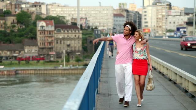 loving couple walking across bridge - mid adult couple stock videos & royalty-free footage