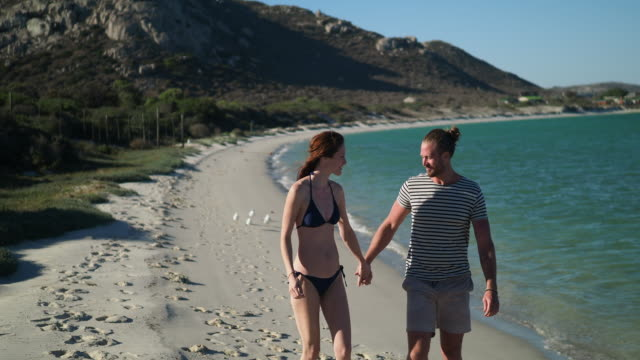 Loving couple walking at beautiful beach