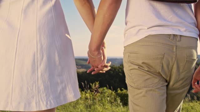 loving couple walking in the meadow - prekmurje stock videos & royalty-free footage