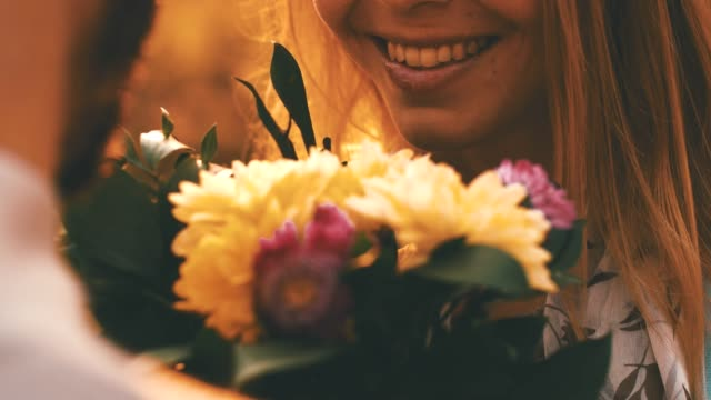 loving couple with flowers - back lit flower stock videos & royalty-free footage