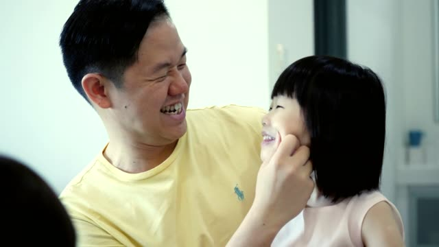 loving dad is playful with his adorable preschool age daughter - pinching stock videos & royalty-free footage