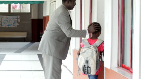 loving daddy hugging daughter as he leaves her at school for class - latin america stock videos & royalty-free footage