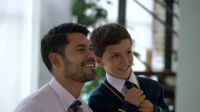 loving daddy teaching his son how to do his necktie - school uniform stock videos & royalty-free footage