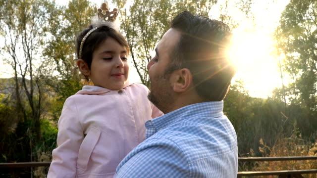 loving daughter hugging her dad at city park - princess stock videos & royalty-free footage