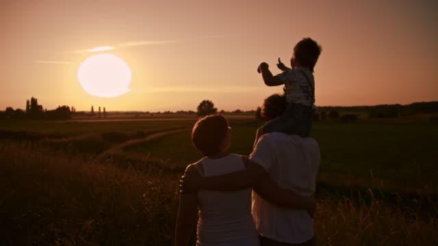 SLO MO Loving family enjoying the sunset
