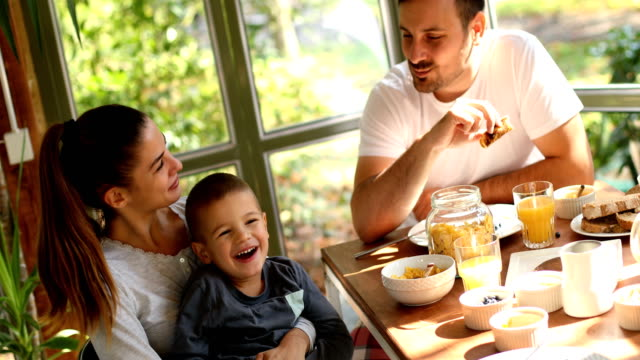 loving family having breakfast - day stock videos & royalty-free footage