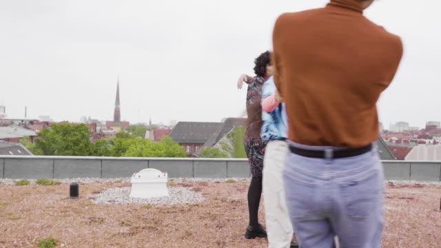 loving gay friends having fun on roof top - ゲイ点の映像素材/bロール