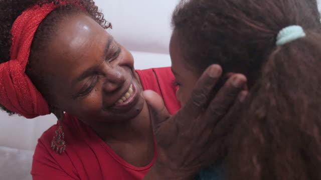 vídeos de stock, filmes e b-roll de avó loving que abraça seu neto - avó