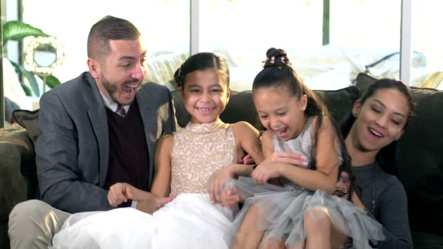 loving hispanic couple alone, then joined by daughters - 6 7 years stock videos & royalty-free footage