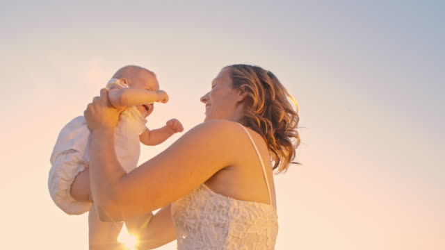 slo mo loving mother against sky at sunset - sundress stock videos & royalty-free footage