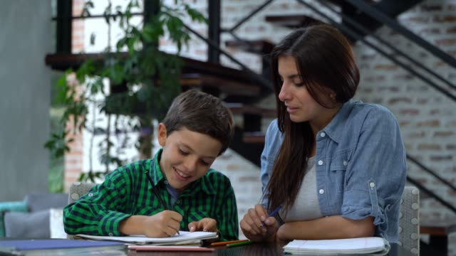 loving mother homeschooling her son explaining a task - school supplies stock videos & royalty-free footage