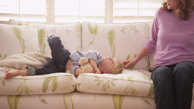 loving mother tickling her young male child - tickling stock videos & royalty-free footage