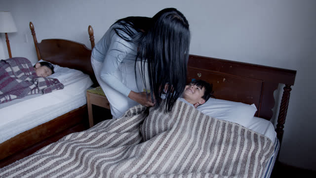 loving mother waking up her kids at a rural home - colombia stock videos & royalty-free footage