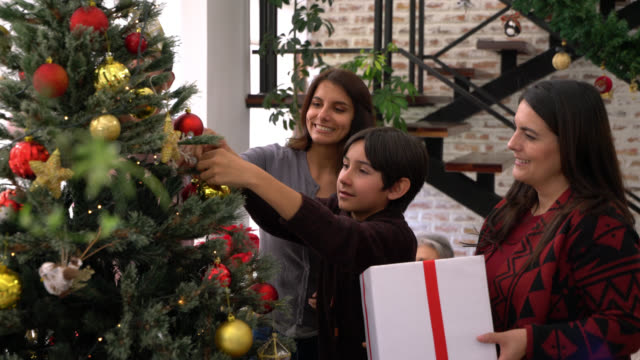 loving multi generational family decorating a christmas tree at home - decoration stock videos & royalty-free footage