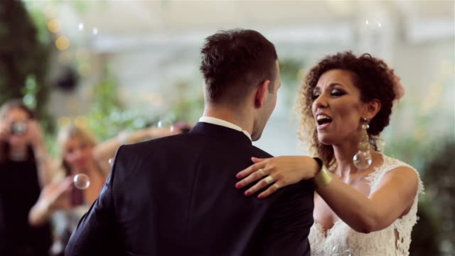 loving newlywed couple dancing the first dance at wedding - wedding stock videos and b-roll footage