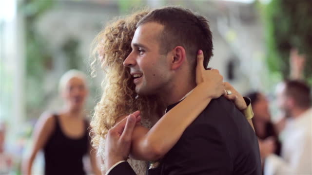 Loving newlywed couple dancing the first dance at wedding