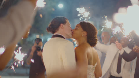 loving newlyweds stop and kiss during their sparkler send off - husband stock videos & royalty-free footage
