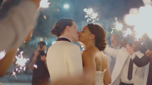 loving newlyweds stop and kiss during their sparkler send off - 4k resolution stock videos & royalty-free footage