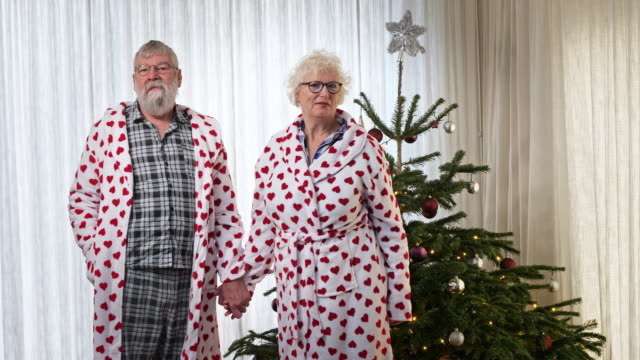 loving senior couple are kissing, christmas - wife stock videos & royalty-free footage
