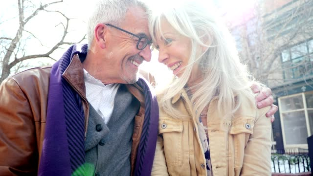 loving senior couple enjoy time together outdoors - heterosexual couple stock videos & royalty-free footage