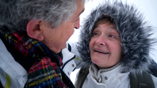 loving senior couple kissing in winter nature - i love you stock videos and b-roll footage