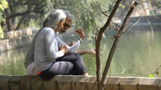 loving senior couple spending leisure time by lakeshore - grey hair stock videos & royalty-free footage