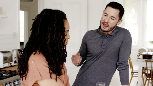 loving transgender couple  talking in kitchen - mixed gender stock videos & royalty-free footage
