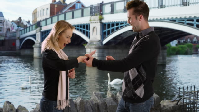 loving young couple get engaged in europe - engagement stock videos and b-roll footage