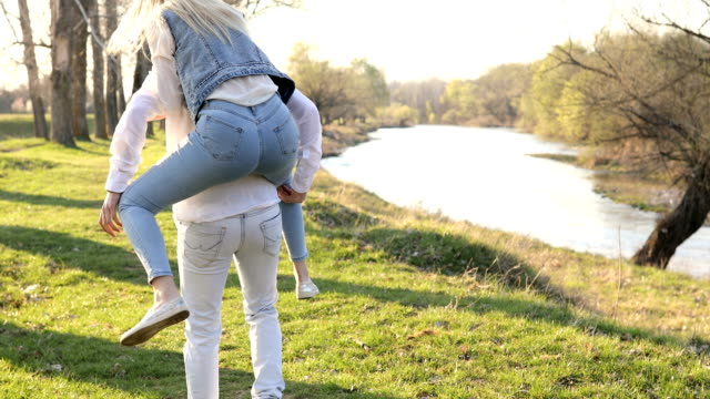 loving young couple walking by the river - blonde hair stock videos and b-roll footage