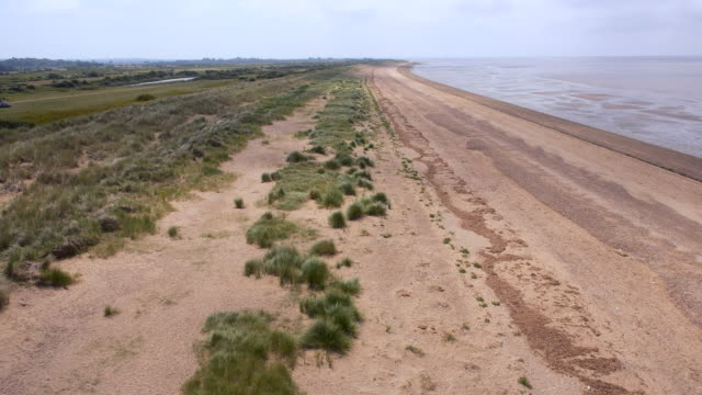 low aerial along heacham beach - norfolk england stock videos & royalty-free footage