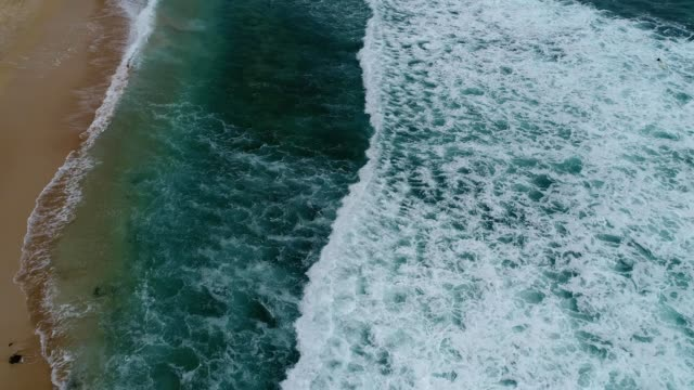 low aerial flight over the shore of electric beach in honolulu hawaii - honolulu stock videos and b-roll footage