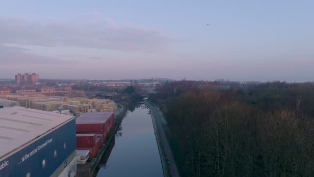 low aerial view flying along ellesmere port canal early frosty morning - canal stock videos & royalty-free footage