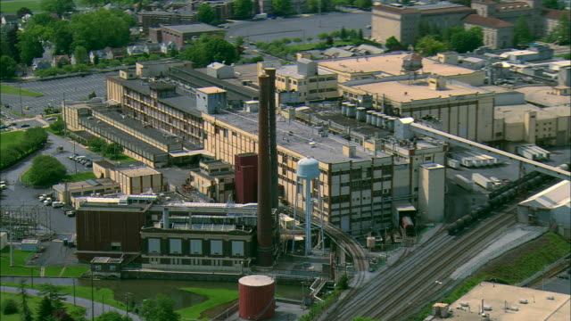 low altitude aerial shot of the hershey chocolate factory at hershey, pa - food processing plant stock videos and b-roll footage