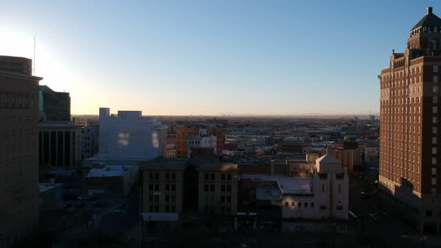 low altitude drone view of downtown el paso early in the morning as the sunrise lights up the city with the us, mexico border on the horizon. - chihuahua stock videos & royalty-free footage