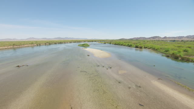 ws aerial pov low altitude flight over colorado river / california, united states  - riverbed stock videos & royalty-free footage