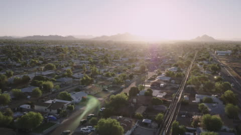 low altitude flight over neighborhood, camera tilts up into sky - zoom out stock-videos und b-roll-filmmaterial